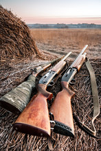 Hunting Shotguns On Haystack, Soft Focus On Shutgun Butt