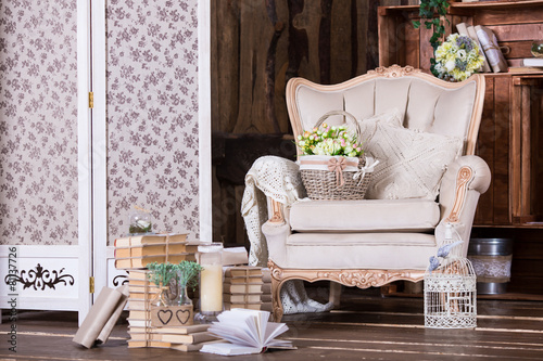 Papiers peints Retro Beautiful vintage interior with old chair and book heaps