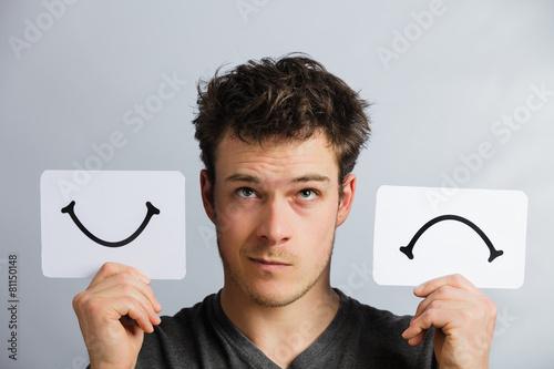 Fotografie, Obraz  Portrait of a Person Holding Happy and Unhappy Mood Board