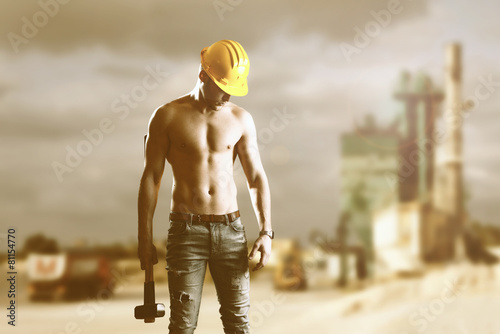 Fotografie, Obraz  Muscular man holding hammer