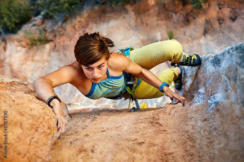 Rock climber climbing up a cliff Canvas Print