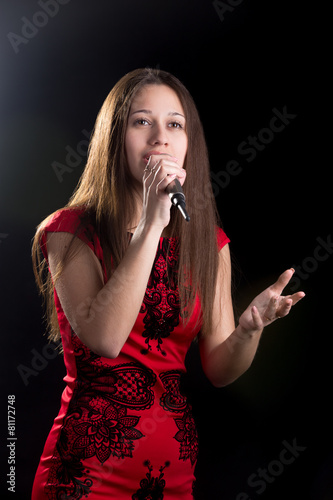 Photo  Young female singer in red dress
