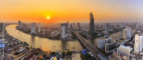 Poster Bangkok River in Bangkok city with high office building at sunset