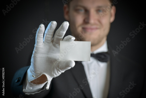 butler wearing white gloves and holding a business card Canvas Print