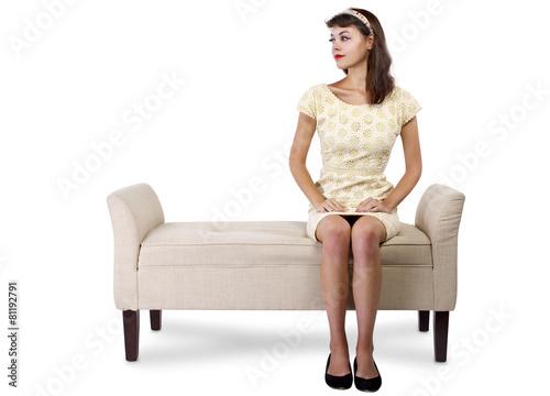 Fotografie, Obraz  Stylish retro female sitting on a chaise lounge or sofa