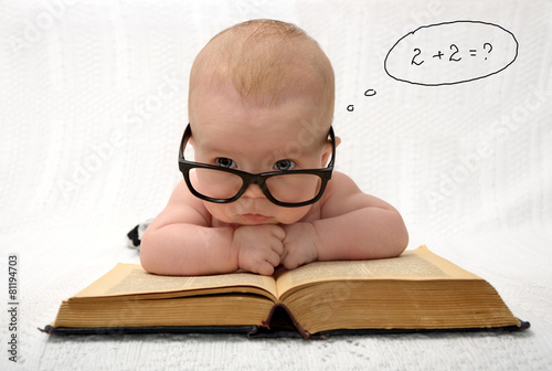 baby in glasses counting in mind Canvas Print