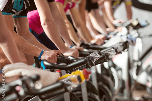 gym detail shot - people cycling, spinning class Wallpaper Mural