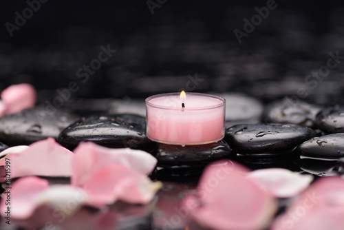 Staande foto Spa Still life with rose petals with candle and therapy stones