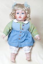 Blue-eyed Girl Doll Sitting On...