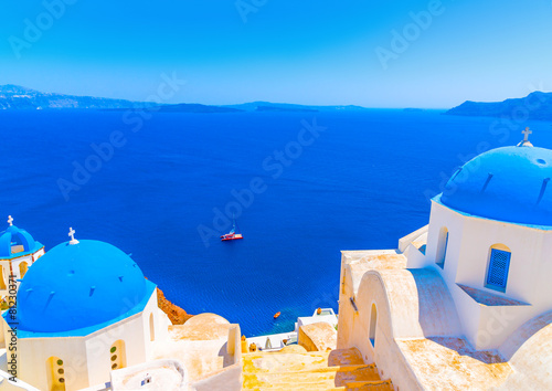 churches with blue domes in Oia at Santorini island in Greece