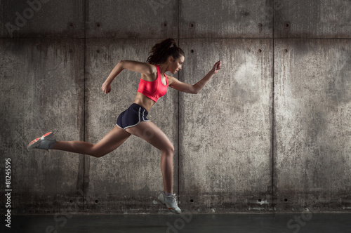 фотографія  Side view of running woman