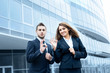 Successful young business people showing ok sign