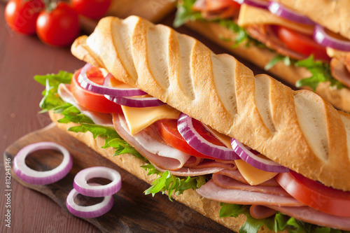 Staande foto Snack long baguette sandwich with ham cheese tomato lettuce