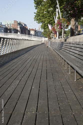 Photo  Sidewalk and Ha'Penny Bridge, River Liffey; Dublin