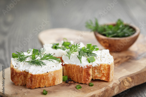 Cuadros en Lienzo homemade appetizing crostini with soft cheese cream herbs