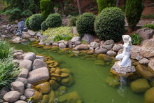 Pond With A Statue In South Garden