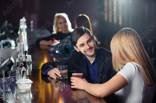 Fotografie, Tablou Couple has a drink in bar