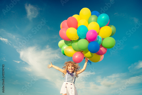 Child with toy balloons in spring field Canvas Print