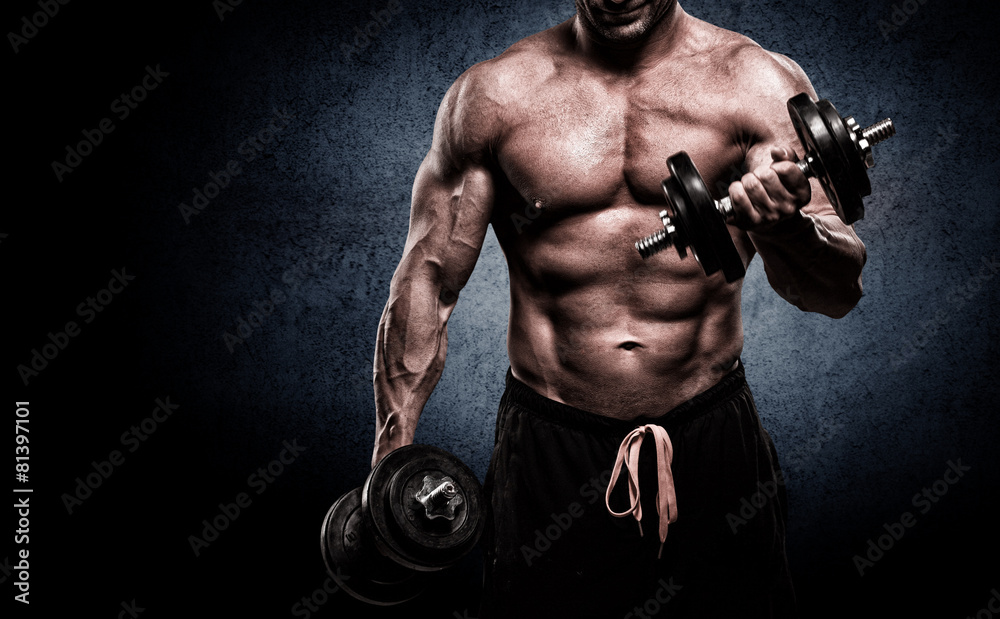 Fotografie, Obraz Closeup of a muscular young man lifting weights on dark backgrou