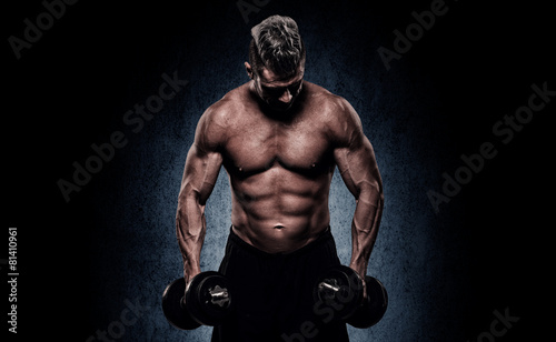 Spoed Foto op Canvas Fitness Cropped image of young muscular man doing heavy dumbbell exercis