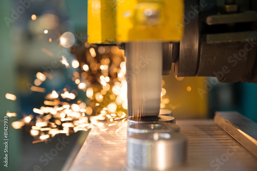 Fototapeta Finishing metal working on horizontal surface grinder machine obraz