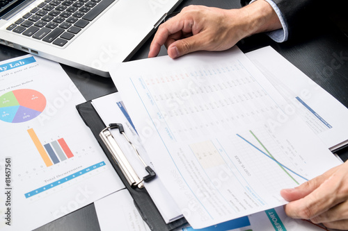 Tela businessman looking charts and graphs results