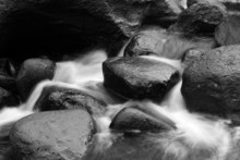 Water Flowing Between Rocks