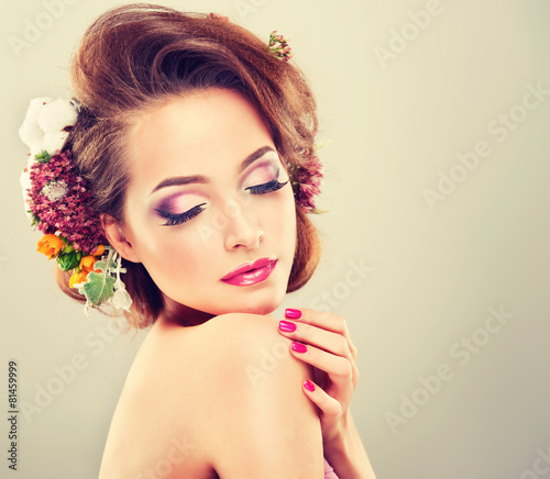 Valokuva  Spring freshness. Girl with delicate pastel flowers in hair