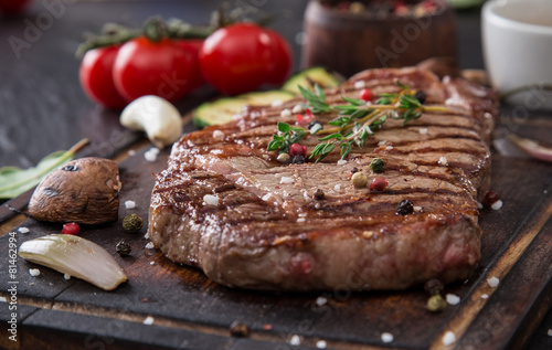 Beef rump steak on black stone table Poster