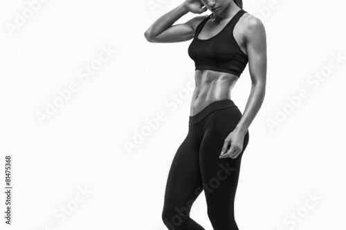 Fitness sporty woman showing her well trained body Canvas Print