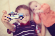 Brothers Playing With A Car