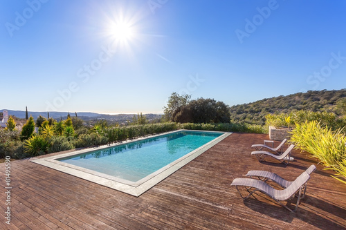 Fotografie, Obraz  Luxury swimming pool for holidays. In the park with the sun.