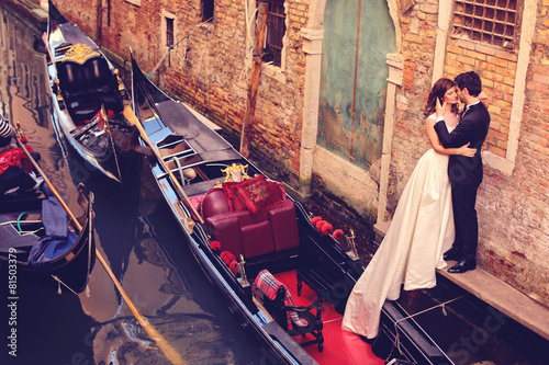 Bride and groom embracing in Venice