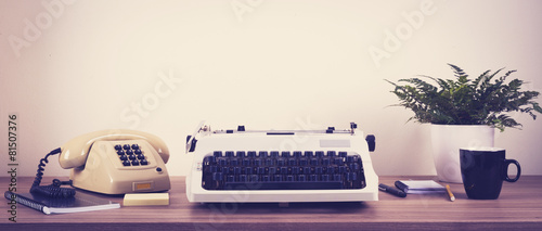 Foto op Canvas Retro Vintage typewriter and phone office
