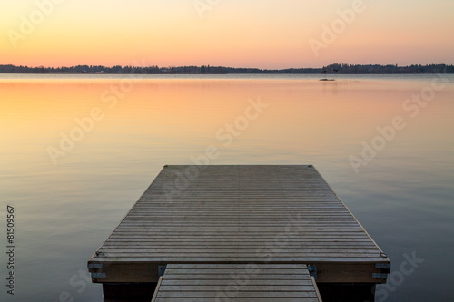 Tuinposter Meer / Vijver Wooden pier in the Scandinavian evening lake