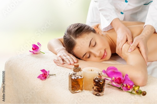 Fototapety, obrazy: Spa. Masseur doing massage on woman body in the spa salon
