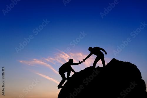 Fotografie, Obraz  Silhouette of helping hand between two climber