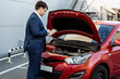 manager checking car condition on tablet
