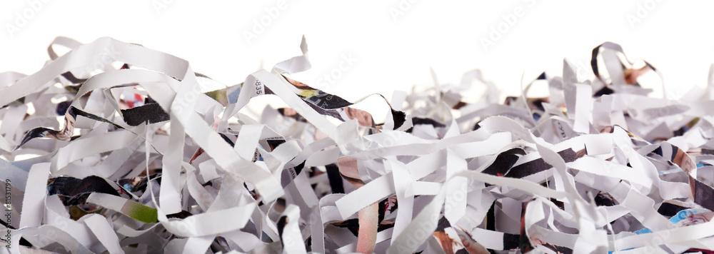 Fototapeta Strips of destroyed paper from shredder isolated on white