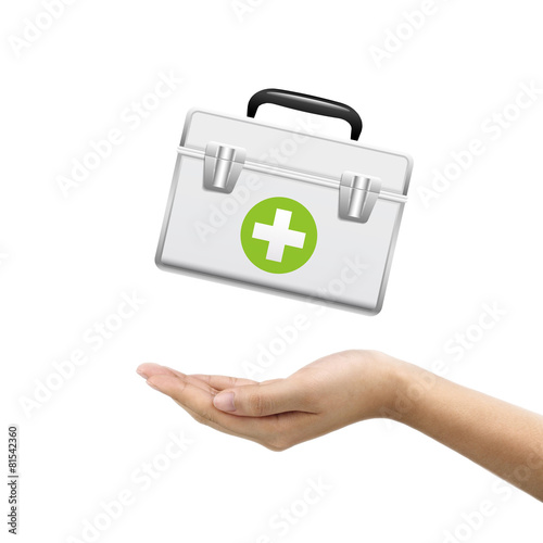 businessman's hand holding first aid kit - Buy this stock photo and