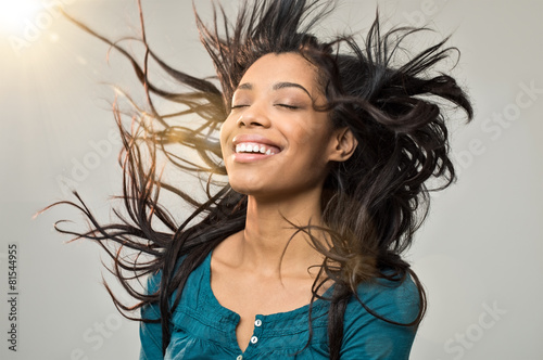 Joyful woman with hairstyle