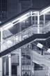 Futuristic stairway and pedestrian walkway in modern building