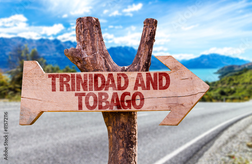 Spoed Foto op Canvas Canada Trinidad and Tobago wooden sign with road background
