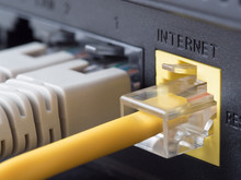 Network Cables Connected To A Router Or Modem
