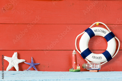 Fotografie, Obraz  Lifebuoy with Welcome on Board phrase on wooden background
