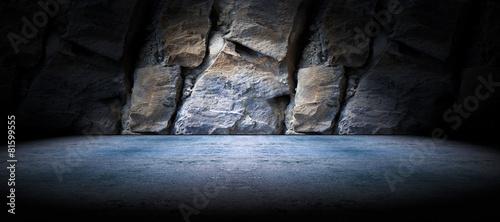 Fondo suelo de cemento y pared de roca Fototapet