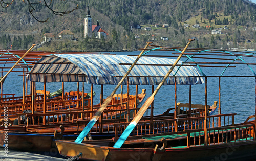 Poster Stadion rowboats moored on the shore of Lake Bled in Slovenia