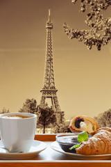 Fototapeta Do kawiarni Coffee with croissants against Eiffel Tower in Paris, France