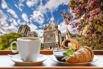 FototapetaNotre Dame cathedral with coffee and croissants in Paris, France