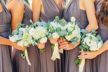 Bridesmaids In Brown With Wedd...